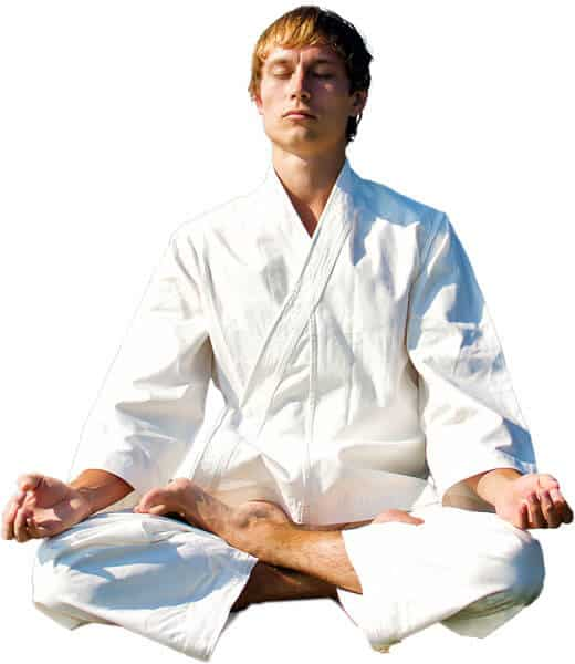 Martial Arts Lessons for Adults in Arvada CO - Young Man Thinking and Meditating in White
