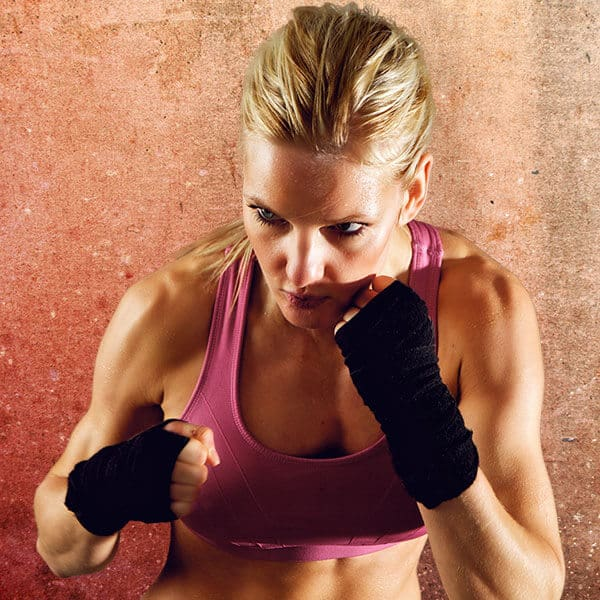 Mixed Martial Arts Lessons for Adults in Arvada CO - Lady Kickboxing Focused Background