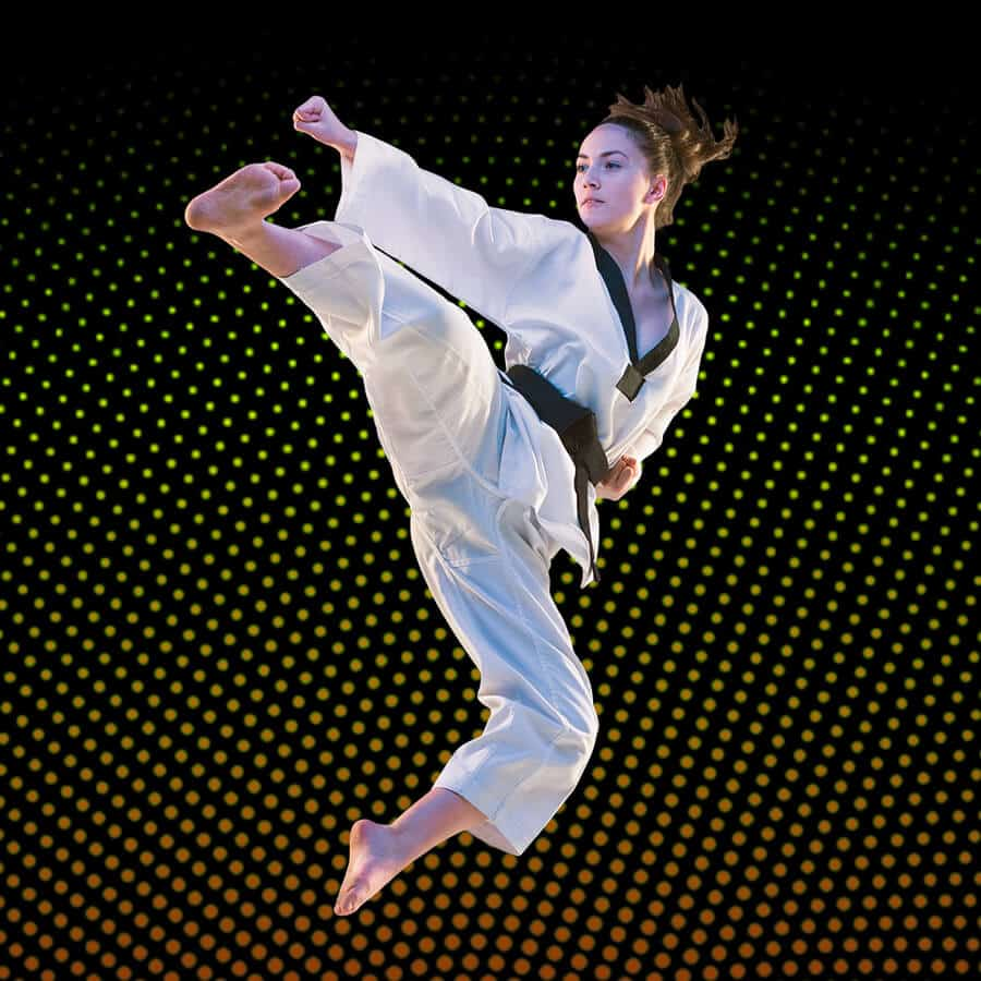 Martial Arts Lessons for Adults in Arvada CO - Girl Black Belt Jumping High Kick