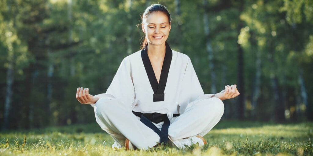 Martial Arts Lessons for Adults in Arvada CO - Happy Woman Meditated Sitting Background