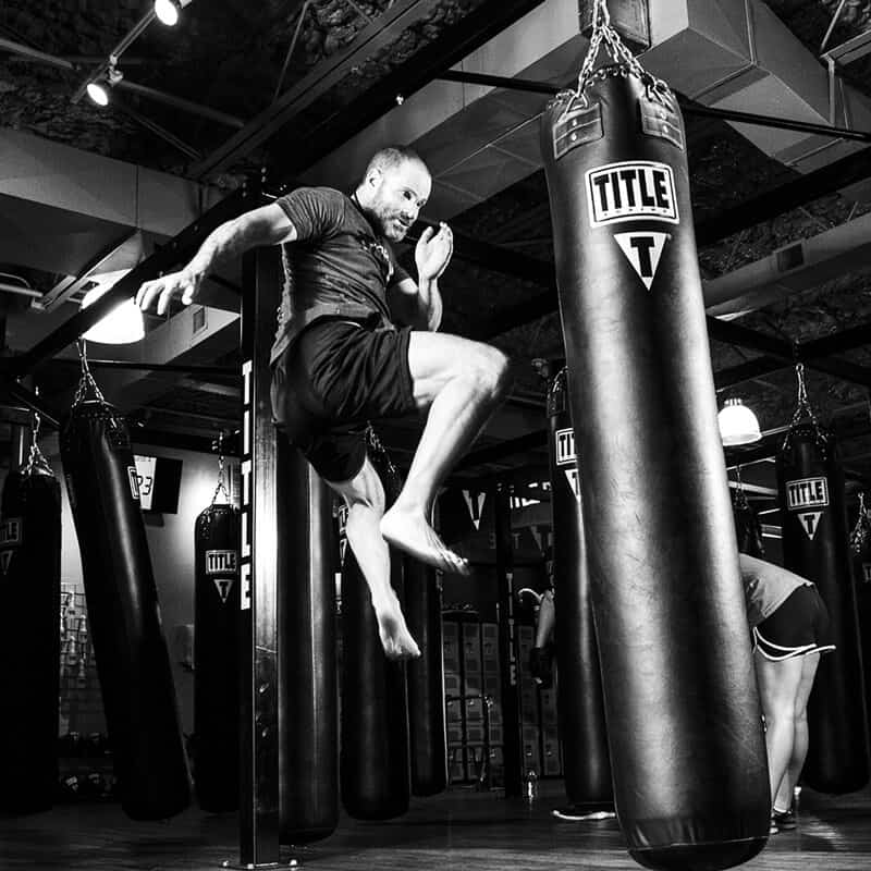 Mixed Martial Arts Lessons for Adults in Arvada CO - Flying Knee Black and White MMA