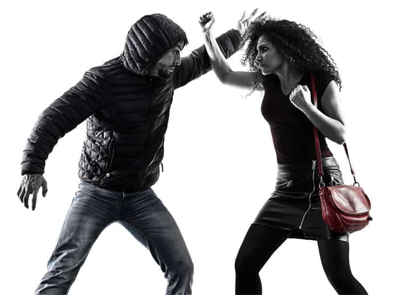Self-Defense Program for Adults in Arvada CO - Blocking Punch Woman